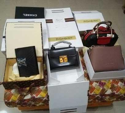 laura-ikeji-fake-hand-bags.jpg